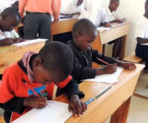 African children studying at their desks.