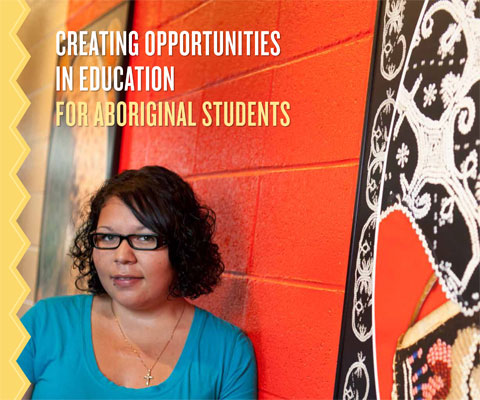 Indigenous woman student in front of red wall.