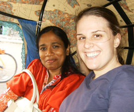 An Indian and Canadian female students in a rickshaw in India.