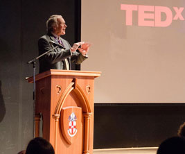 Bishop's University: Male speaker at the TEDxBishopsU event.