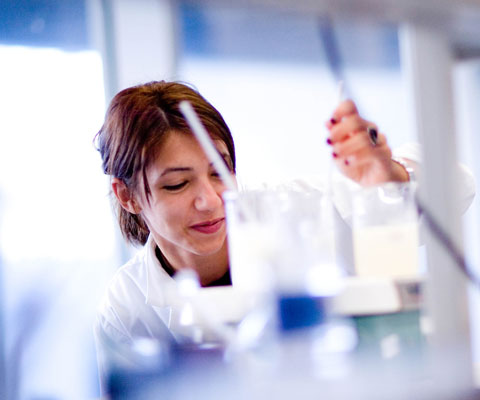 Female researcher working in a lab.