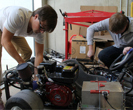 Two engineering students working on equipment