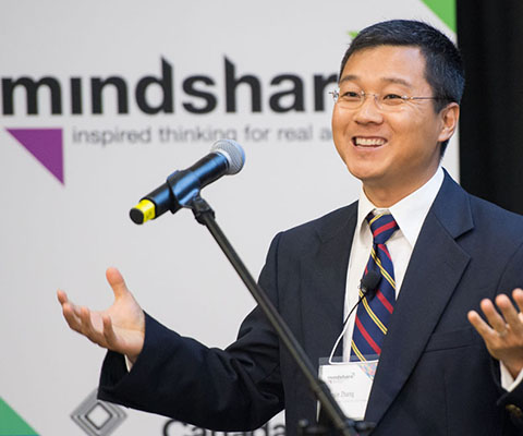 Junjie Zhang at microphone at Mindshare event: What