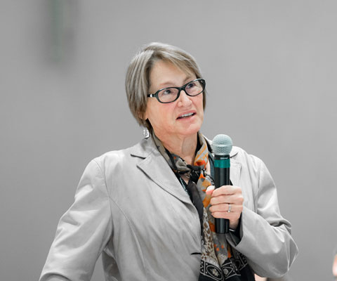 Suzanne Fortier, principal of McGill University, speaking with a microphone.