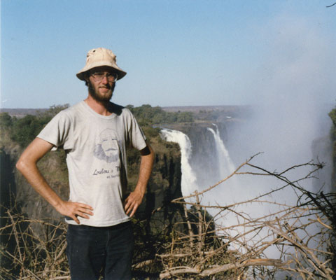 Paul Davidson, president of Universities Canada, as a university student in front of falls in Africa.