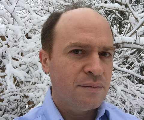 Daneil Wise standing in front of a tree in the winter