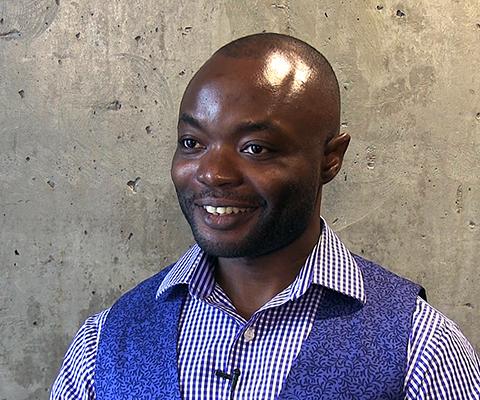 University of Winnipeg student, Oluwayemisi Olugboji, smiling at the camera.