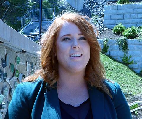 Stacey De Molitor, a student at Mount Saint Vincent University, standing on campus.