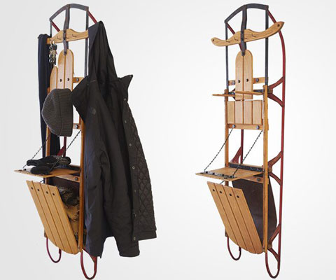 An old, wooden luge that has been transformed into a functional wardrobe.