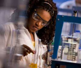Young black woman researcher working in a lab.