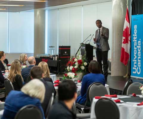 Aylmer MP Greg Fergus speaks to a crowd at the launch of the Open Door, Open Knowledge event at Carleton University.
