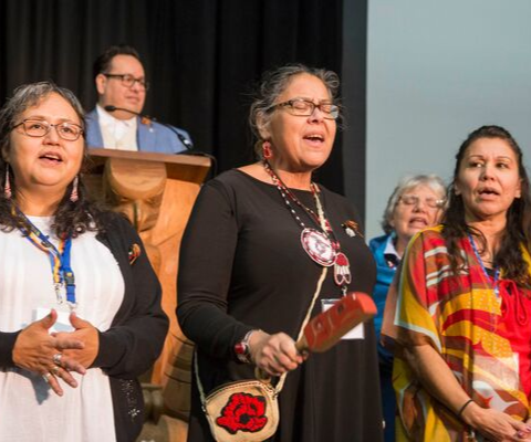 Three Indigenous Elders perform a traditional First Nations song at the 2018 Building Reconciliation Forum.
