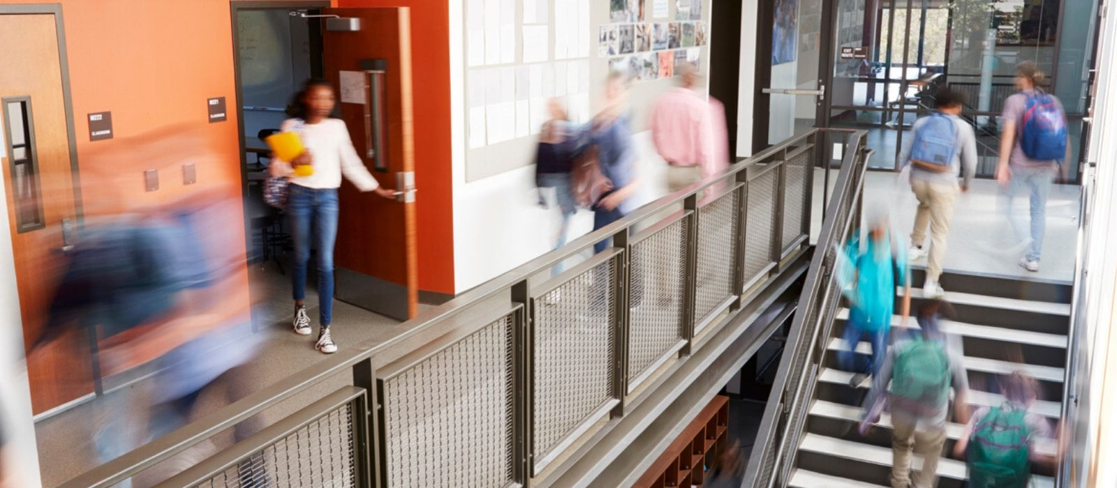 A busy university hallways filled with blurred images of students and professors.