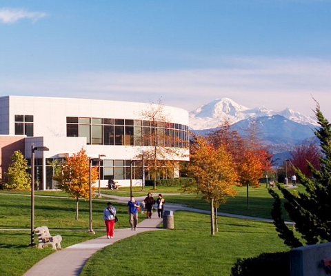 Campus of University of The Fraser Valley with the Coast Mountains in the background.