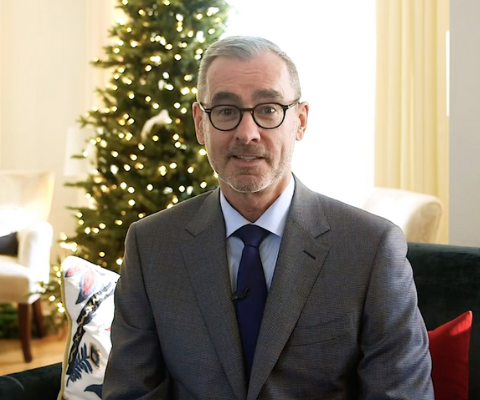 Bill Flanagan, president of the University of Alberta, sits in his living rooms to deliver a virtual greeting.
